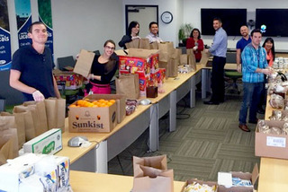 Image of ESET employees preparing donations for local food bank.